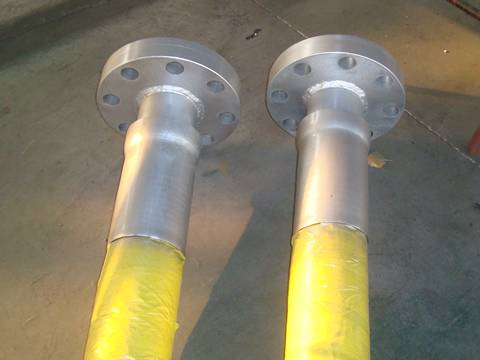 Two rotary drilling hose with flanges on the ground.
