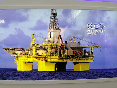 A large set of equipment for oil exploration is on the sea.