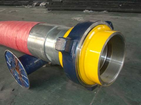 A large diameter rotary drilling hose are supported by a axle in the warehouse.