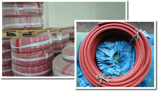 Several packed high pressure steam hoses in the warehouse and a detailed roll.